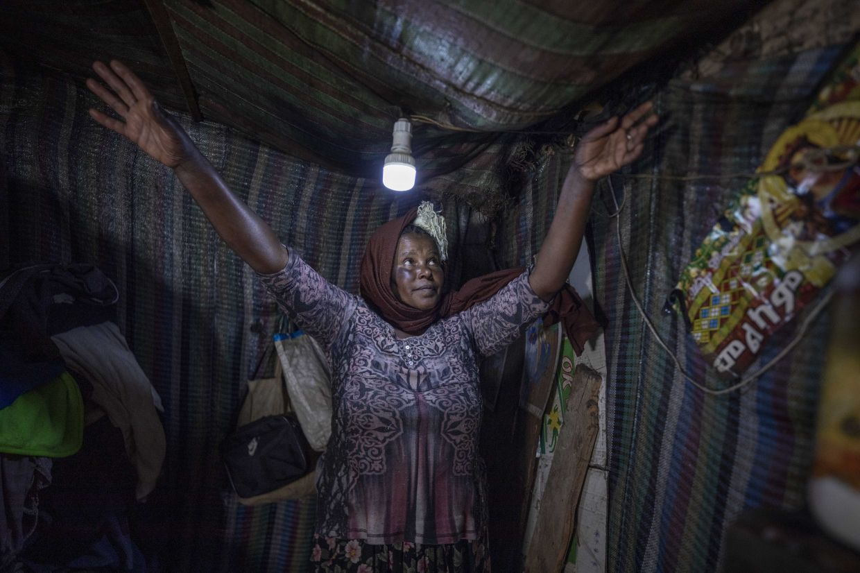 Hailemariam in her tent. Her better-off neighbours who once welcomed her into their homes as a domestic worker, now turn her away, avoiding contact for fear of the virus. Photo: AP/Mulugeta Ayene