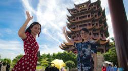 Chinese tourists start to return to Wuhan's attractions as city tries to get back on its feet after coronavirus