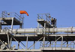 Oil rises 1% on Saudi Aramco's upbeat demand view, Iraq supply cut