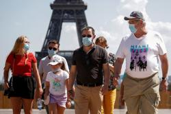 Some tourists confused by new COVID-19 mask rules in Paris