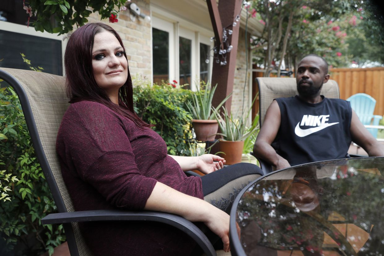 Racobs-Ashford (right) with her husband, Chase, who is disabled, at her mother's home in Dallas. They have two small children (not pictured). Photo: AP/Tony Gutierrez