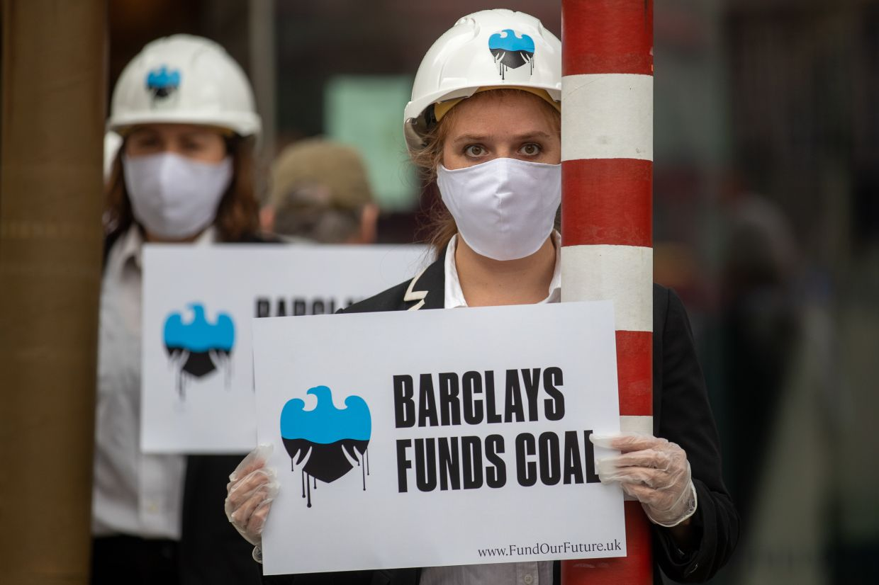 Climate activists protesting outside a Barclays branch in London, pushing for the bank to stop financing coal companies. — Bloomberg