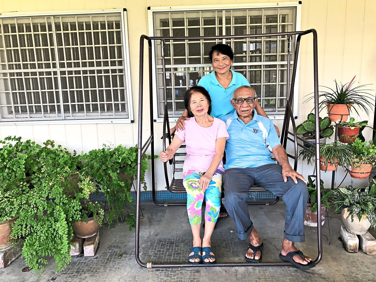 Kak Rose (left) with her daughter and husband at home in Ipoh. Photo: The Star/Ming Teoh