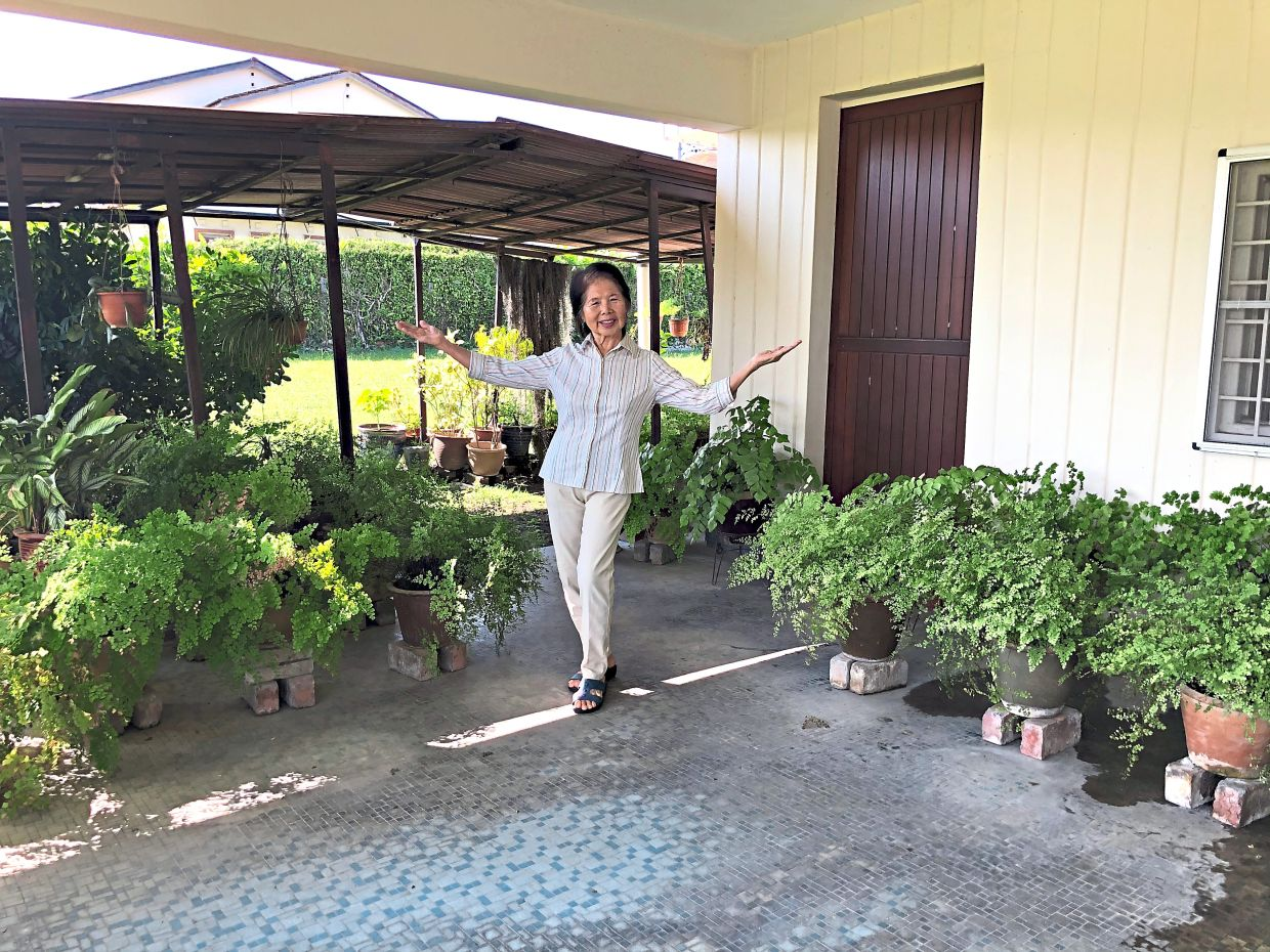 Besides aerobics, Kak Rose also loves gardening. Photo: The Star/Ming Teoh