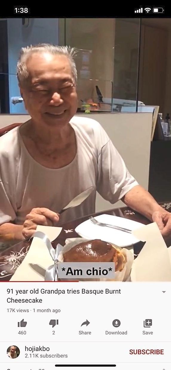 91-year-old Singaporean grandfather smiles shyly after receiving cake from his grandson in celebration of Father's Day. Photo: TikTok