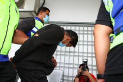 Husband charged with lecturer's murder