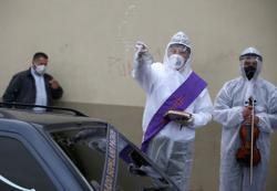Colombia deacon leads funeral rites in PPE as coronavirus cases near 400,000