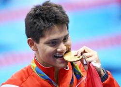 Singapore swim ace Schooling gets national service delay