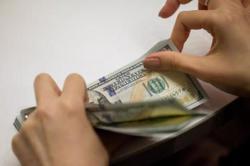 Dollar bump hits Asian currencies, stocks lower