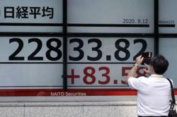 Asian markets mixed as trade hopes play against stimulus worries