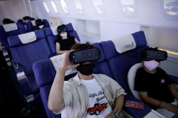 Virtually identical: Grounded Japanese try 'foreign' holidays with a difference