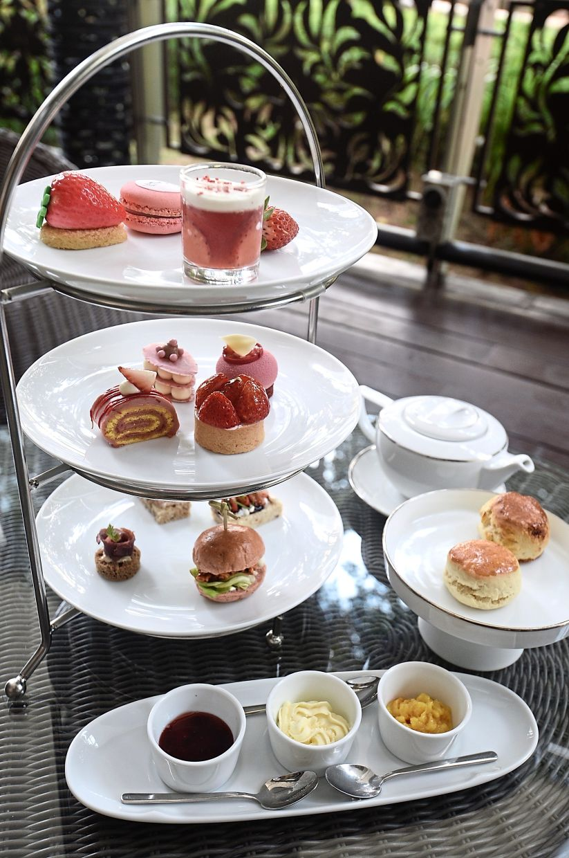 This Chitose Strawberry Afternoon Tea set comes with a  generous  selection of sweet and savoury treats, as well as two types of scones. — SIA HONG KIAU/The Star