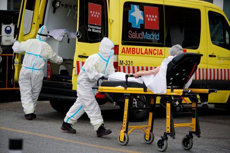 FILE PHOTO A healthcare worker wearing protective gear pushes a stretcher with a patient near the emergency unit of the 12 de Octubre hospital during the coronavirus disease COVID-19 outbreak in Madrid Spain August 10 2020. REUTERSJuan Medina