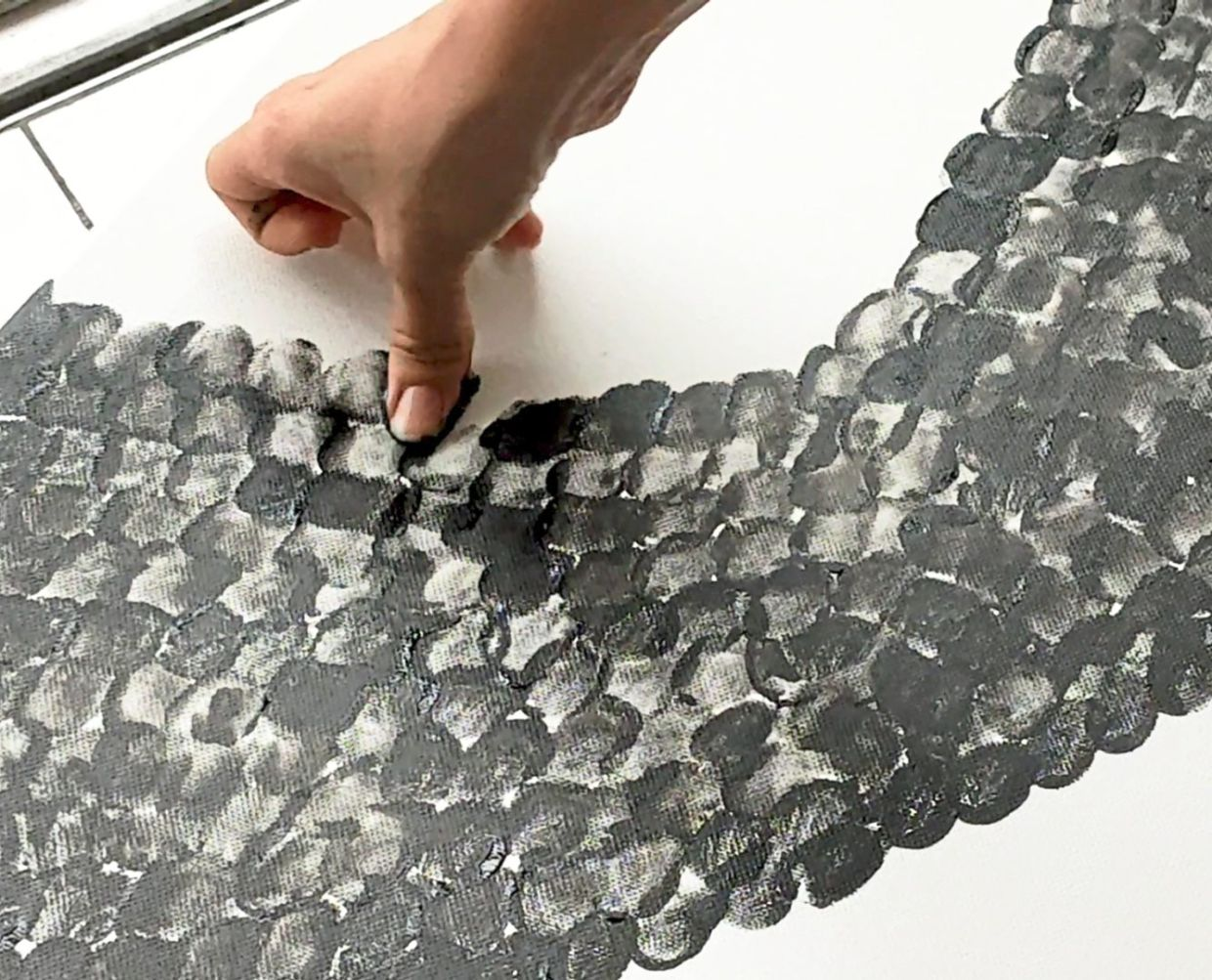 Creating the portrait took thousands of thumbprints, says Ng. Photo: Niuniu's Gallery