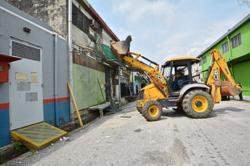 Unhappy over demolition of structures