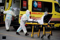 Surge in Spain's virus cases prompts regional smoking ban, field hospital