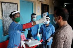 India's coronavirus cases jump by 67,000, setting daily record