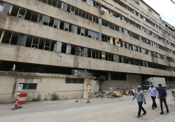 Hardened Lebanese merchants battered by Beirut blast