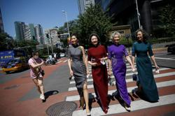 Remove masks, celebrate freedom: fashion grannies return to Beijing street 'catwalk'