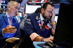 Stocks fall with eyes on US stimulus
