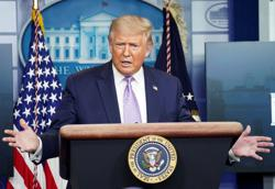 Trump holds up coronavirus aid to block funding for mail-in voting