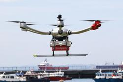 Fried chicken winging its way to hungry sailors in drone delivery test flight