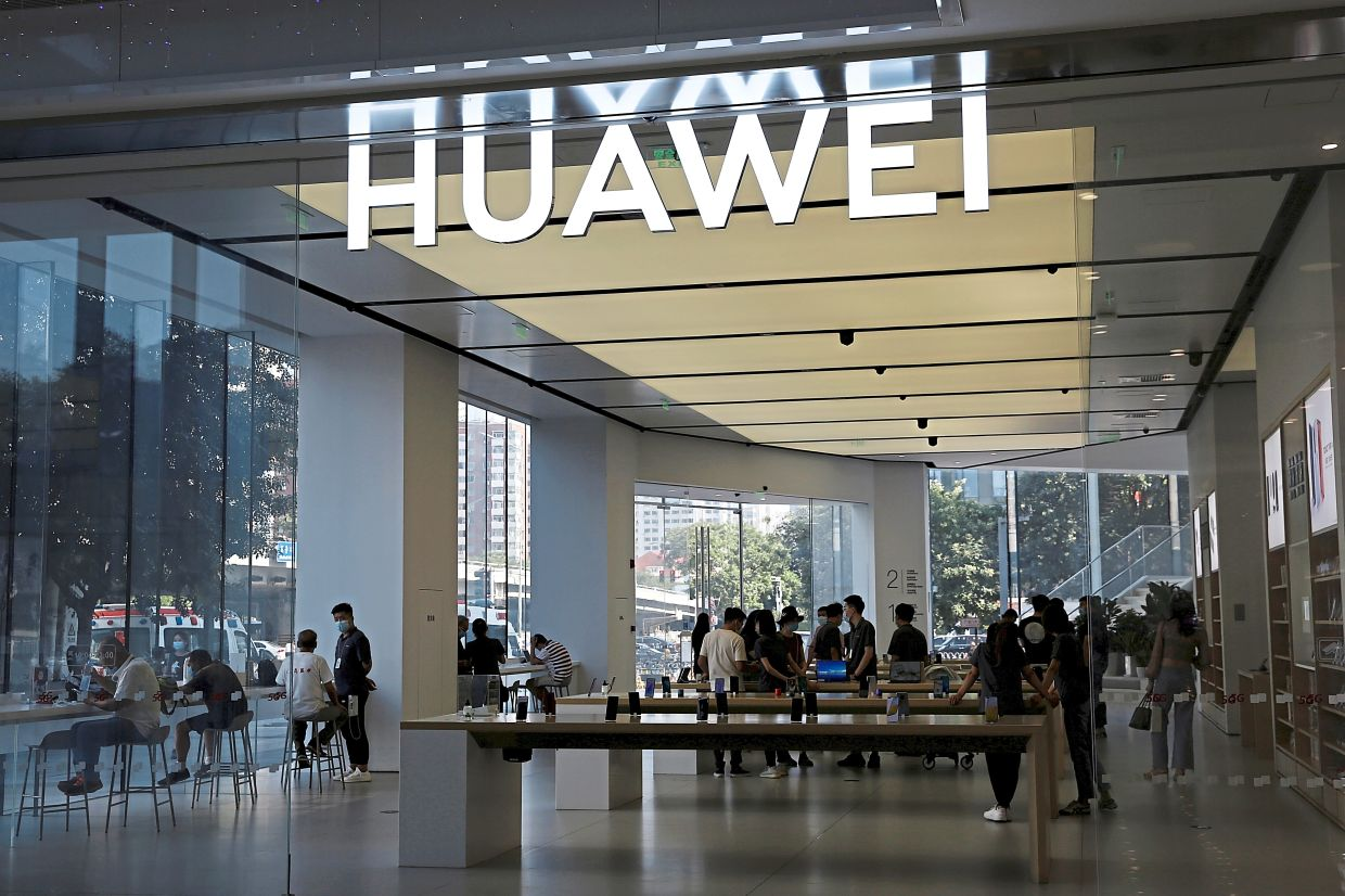 Supply chain disruption: People are seen inside a Huawei store at a shopping mall in Beijing. Huawei is opening its own supply chain with the backing of the Chinese government. — Reuters
