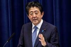 Japan PM Abe sends ritual offering to war dead shrine on WW2 75th anniversary