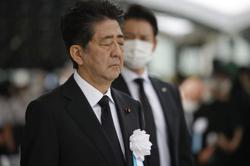 Japan's Abe, on WW2 anniversary, pledges never to repeat tragedy of war