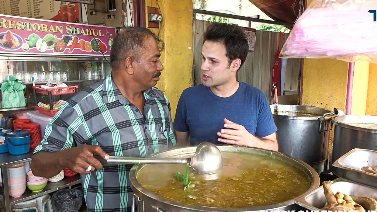 James trying 'torpedo soup' for the first time at Sup Hameed in Penang in 2016.