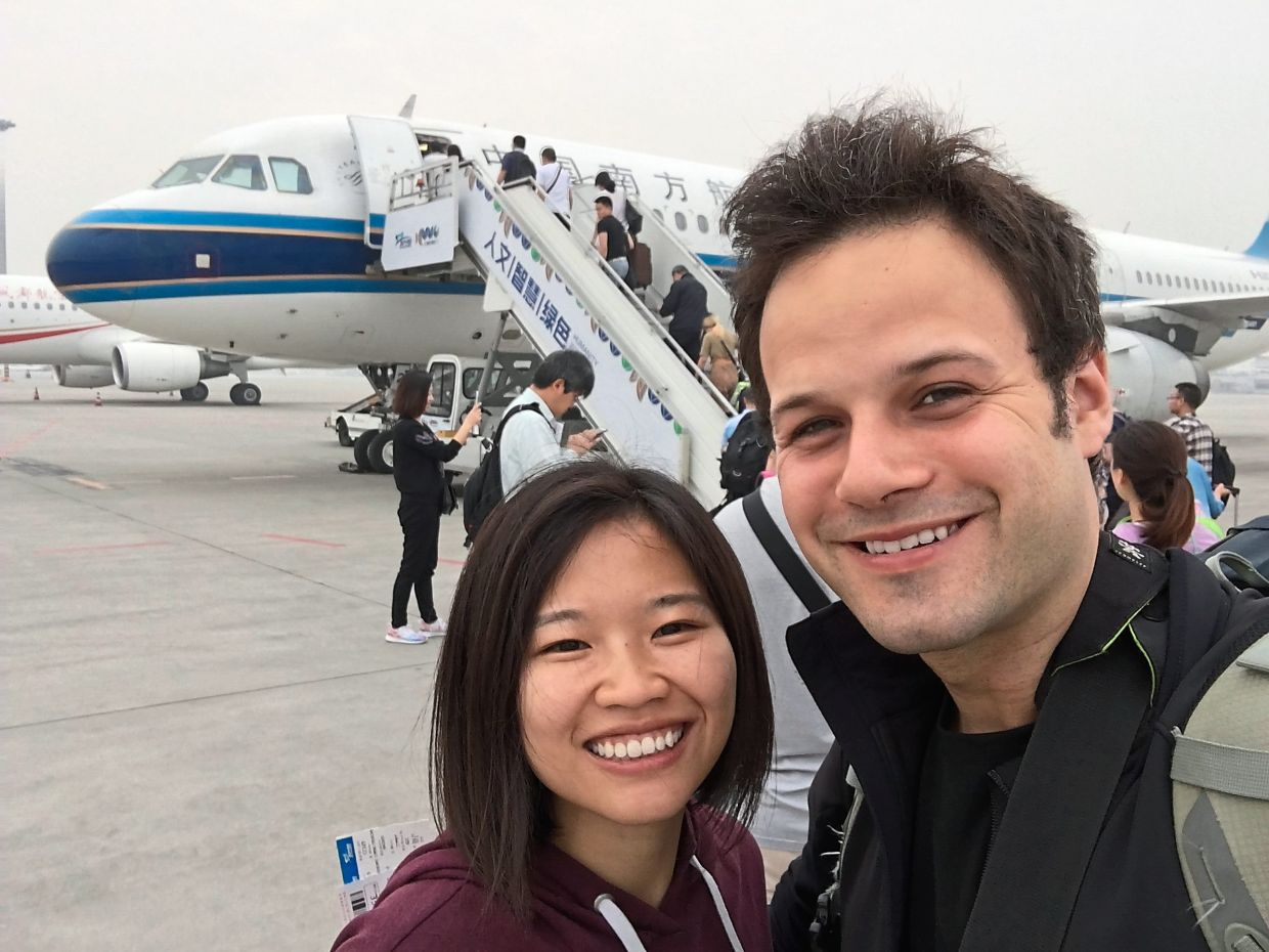 James (right) with his wife Xie on their way back from Turkey to China in July 2015.