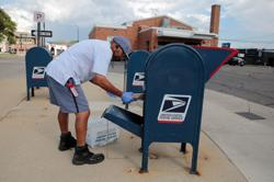 Factbox: 'Reverse the damage' - Officials react to suspension of U.S. Postal Service cuts