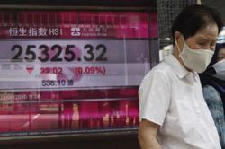 Asian markets edge higher on stimulus hope