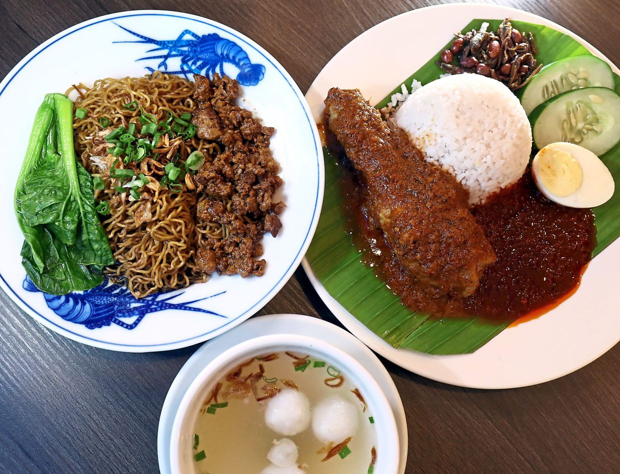 Among the signature dishes sold at the cafe are Nasi Lemak Ayam Rendang (right) and kolok mee.