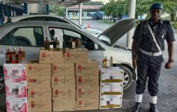 Marine police seize 20 boxes of contraband liquor from abandoned car