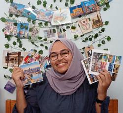 Why are Malaysians still sending postcards?