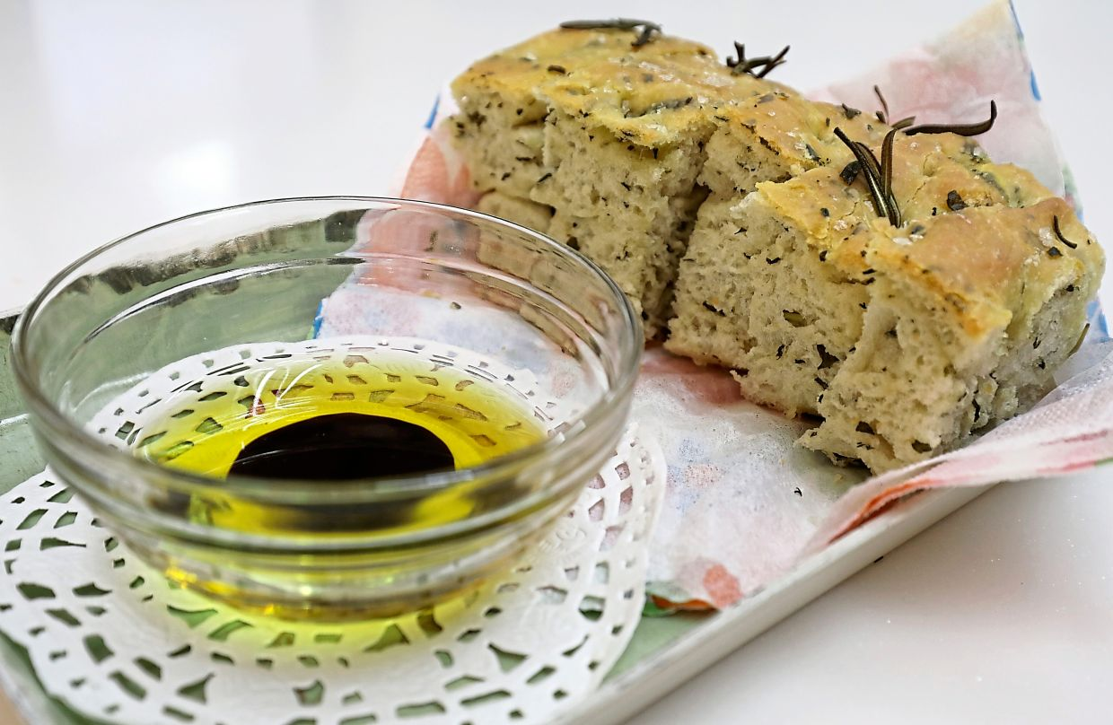 Serve rosemary focaccia warm with a simple dip of extra virgin olive oil and balsamic vinegar. — Photos: SAMUEL ONG/The Star