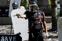 Portland police order protesters to disperse