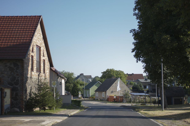 A road between residential buildings is deserted in the village Harnekop at a rural region east of Berlin, Germany.