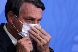 Brazil's Bolsonaro says he wants to punch reporter in face