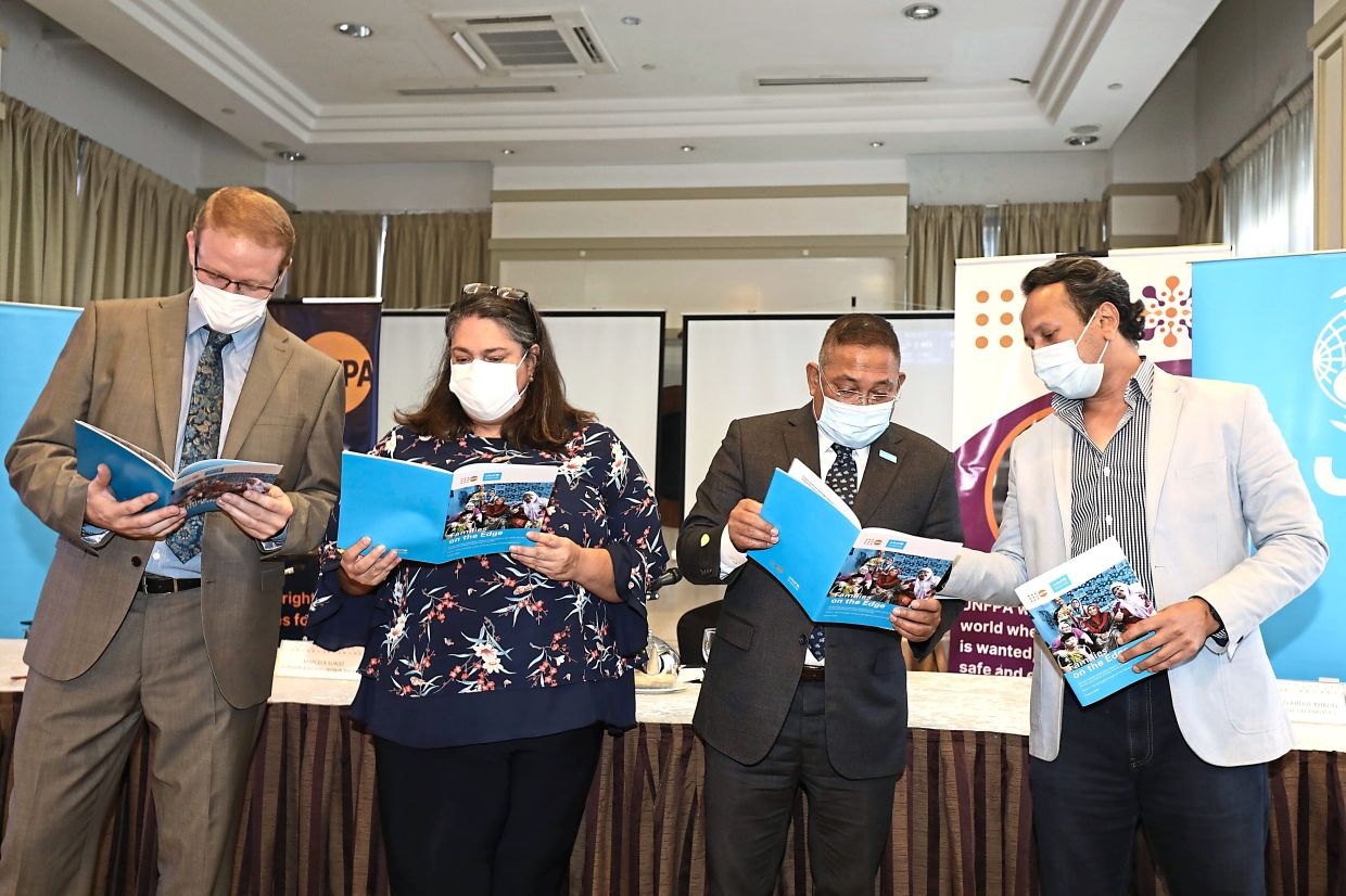 UN study: (From left) Barrett, Suazo, Dr Rashed and Dr Muhammed going through the FoE report. —  SAMUEL ONG/The Star