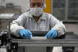 Singapore factory output shrinks for third month in July, with sharper 8.4% fall