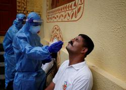 India reports record daily jump of 75,760 coronavirus infections