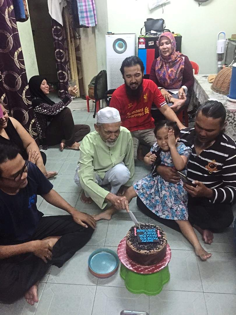 Family matters, as seen through the eyes of 13-year-old Batrisyah, one of the 10 children who participated in the Unicef-UNFPA study. Batrisyah photographs her grandfather's birthday celebration at home in the PPR flats in Seri Semarak, KL. Photo: UNICEF