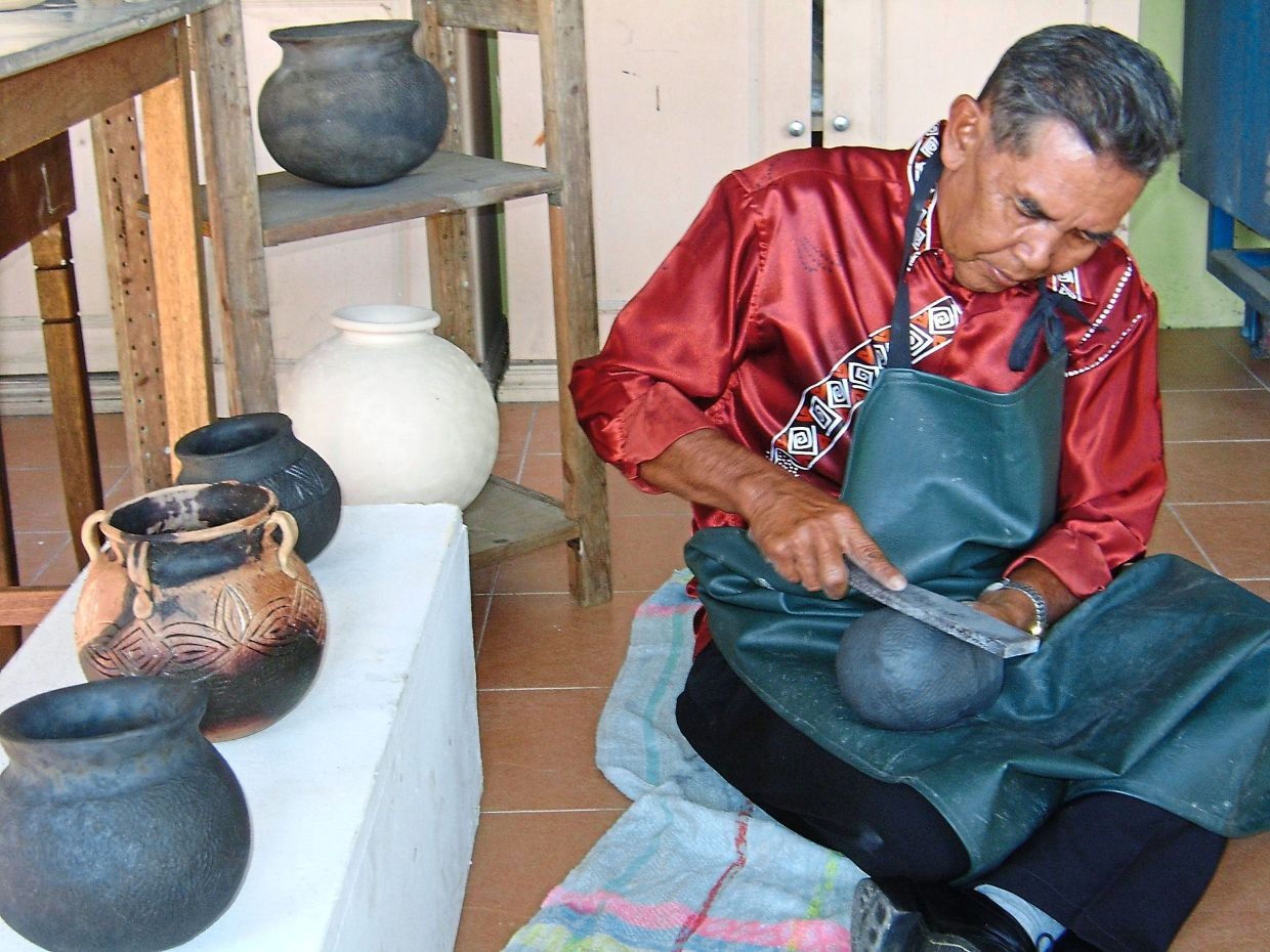 Andah is known for his skills in making Iban crockery.