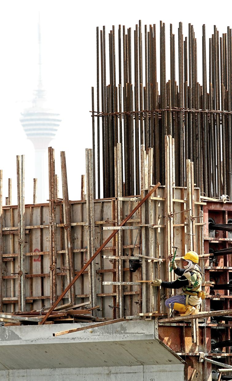 Taking shape: Construction workers at the Bandar Malaysia project which is seen as the main beneficiary of the property play in the HSR project.