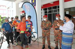 Fireman cycles 2,020km to celebrate National Day