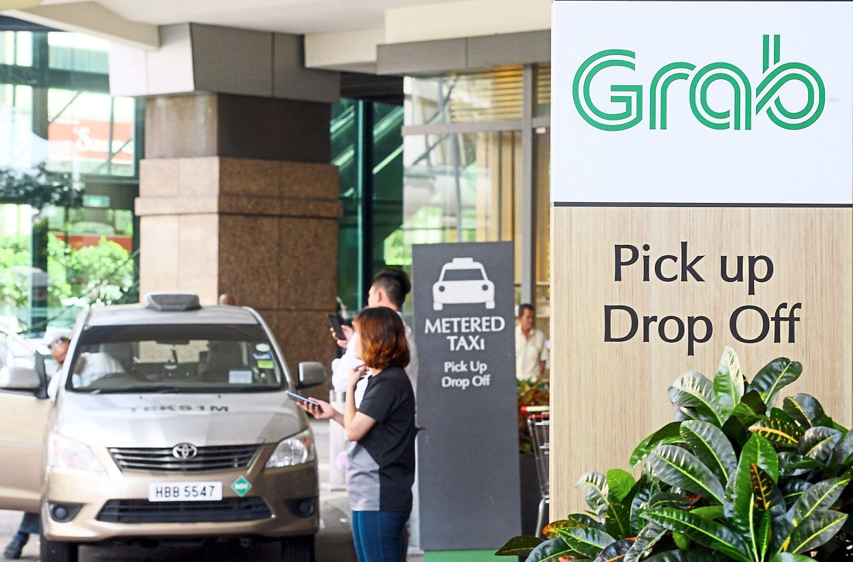 Grab is concerned about some of its driver-partners using external tools to steal jobs from other drivers. — AZHAR MAHFOF/The Star