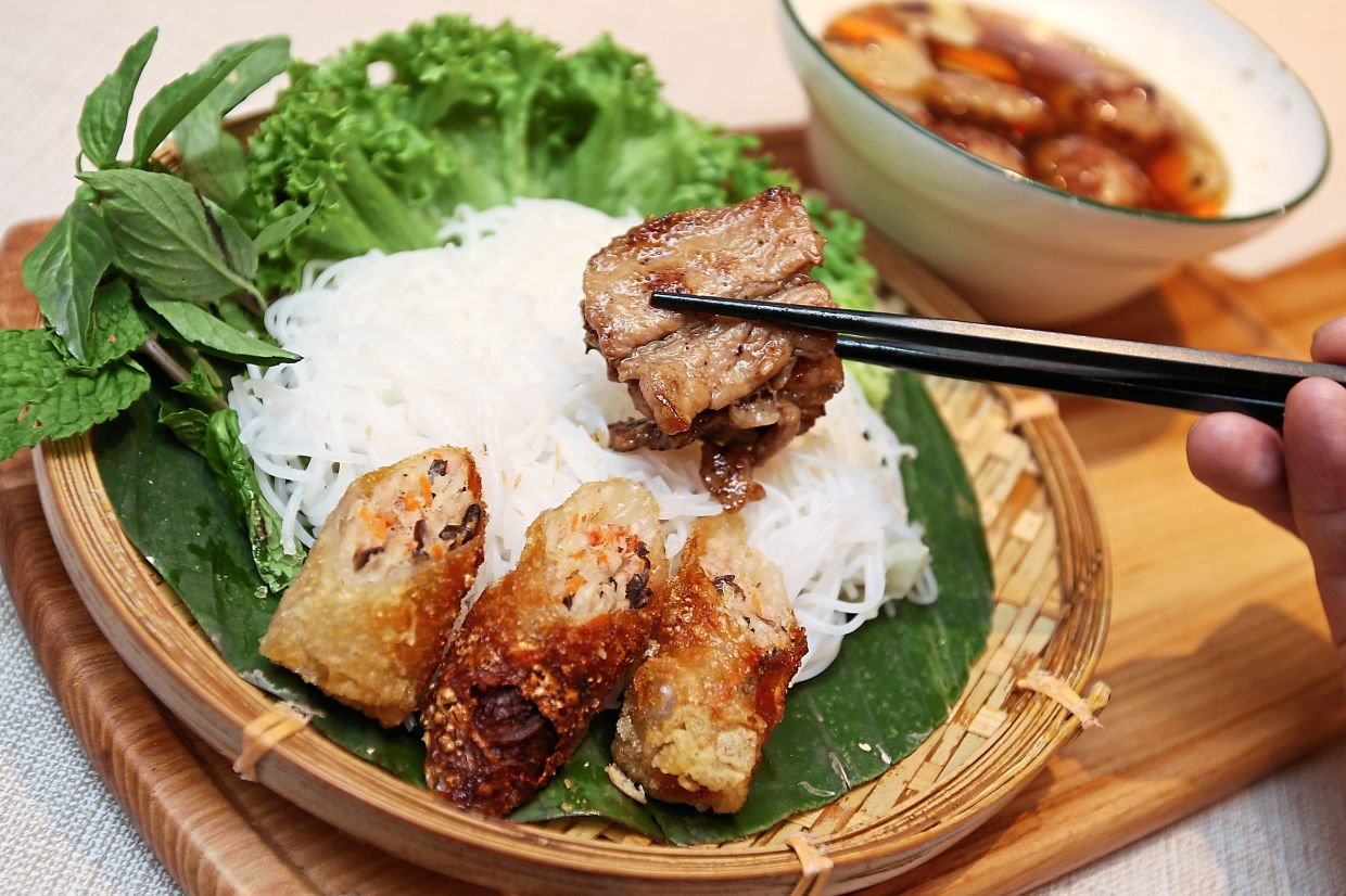 Other dishes in the menu include Hanoian Style Grilled Pork with Vermicelli.