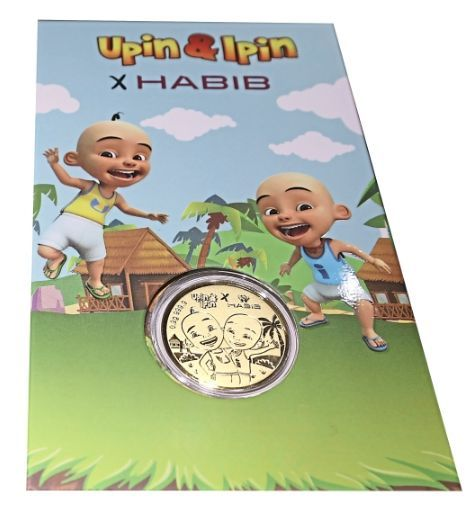 The limited-edition gold coin embossed with the Upin and Ipin characters.